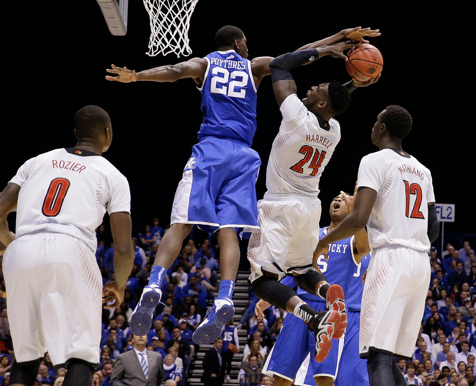 . Kentucky\'s Alex Poythress (22) locks the shot of Louisville\'s Montrezl Harrell (24) during the first half of an NCAA Midwest Regional semifinal college basketball tournament game Friday, March 28, 2014, in Indianapolis. (AP Photo/David J. Phillip)