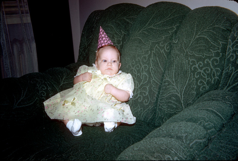 baby susan with party dress in chair.jpg