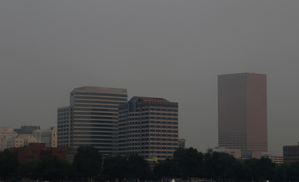 . The downtown skyline is visible through hazy smoke from wildfires in Portland, Ore., Tuesday, Sept. 5, 2017.  The dozens of fires burning across the Western United States and Canada have blanketed the air with choking smoke from Oregon to Colorado, where health officials issued an air quality advisory alert. (AP Photo/Don Ryan)