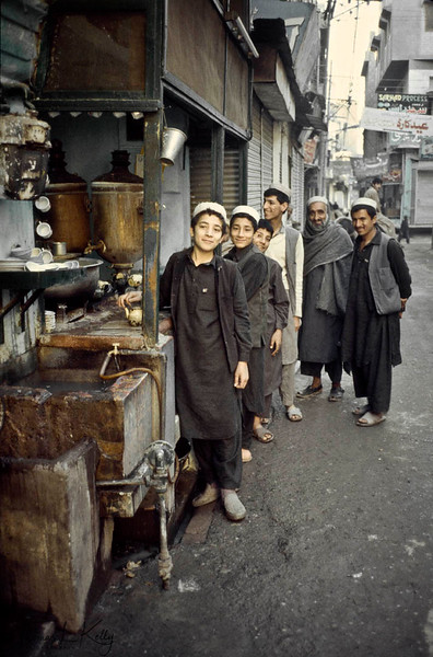 Roving pleasure boy will try to lure customers to stay at particular hotels that employ them. Afghan hotel manager poses with his pleasure boys. Khyber Bazaar, Peshawar.
