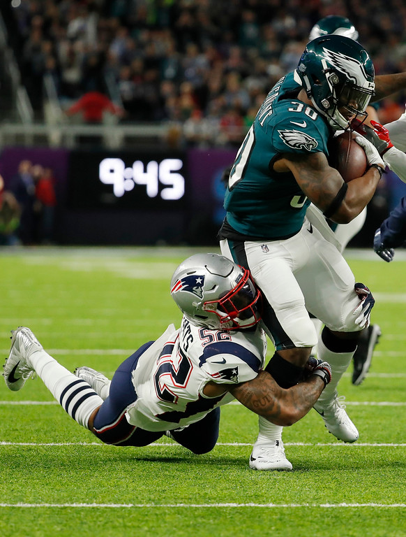 . Philadelphia Eagles running back Corey Clement (30) carries the ball, as New England Patriots outside linebacker Elandon Roberts (52) makes the tackle, during the first half of the NFL Super Bowl 52 football game Sunday, Feb. 4, 2018, in Minneapolis. (AP Photo/Charlie Neibergall)