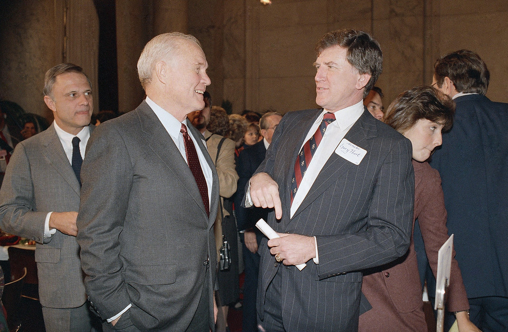 . Sen. John Glenn, D-Ohio, left, talks with Sen. Gary Hart, D-Colo., during a luncheon for Senators and Senators-elect on Capitol Hill, Wednesday, Nov. 19, 1986, Washington, D.C. Hart is in his last session as Colorado Senator. (AP Photo/John Duricka)