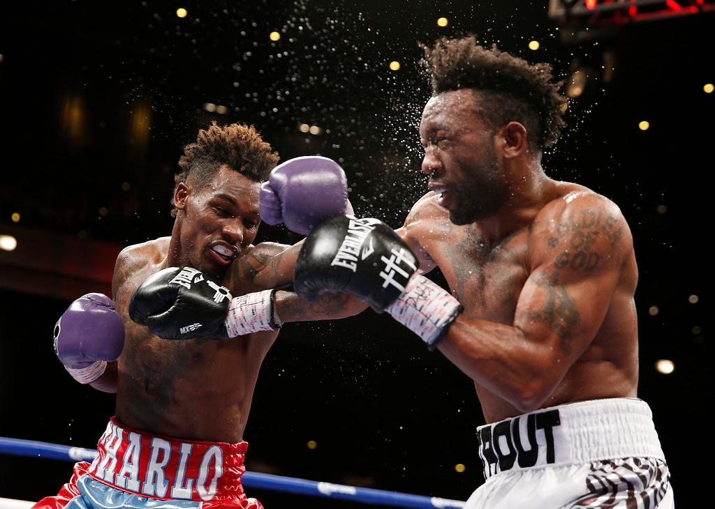 . Jermall Charlo, left, hits Austin Trout in a junior middleweight title fight, Saturday, May 21, 2016, in Las Vegas. (AP Photo/John Locher)