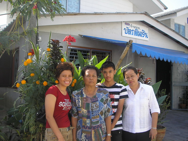 Nui, Big's grandmother, Big & Ajarn Sompit in front of Big's house.