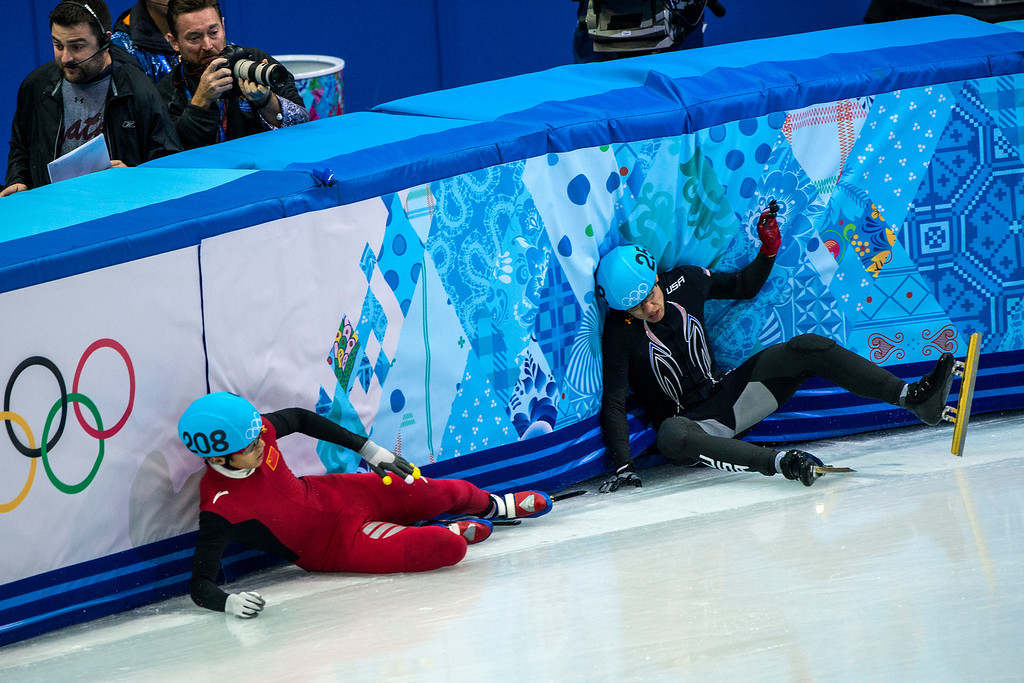 . J.R. Celski, of Salt Lake City, and Dequan Chen, of China, (208) fall after finishing in the 1,500-meter short-track speedskating finals at Iceberg Skating Palace during the 2014 Sochi Olympic Games Monday February 10, 2014. Celski finished in fourth place with a time of 2:15.624, 0.639 behind gold medalist Charles Hamelin of Canada. (Photo by Chris Detrick/The Salt Lake Tribune)