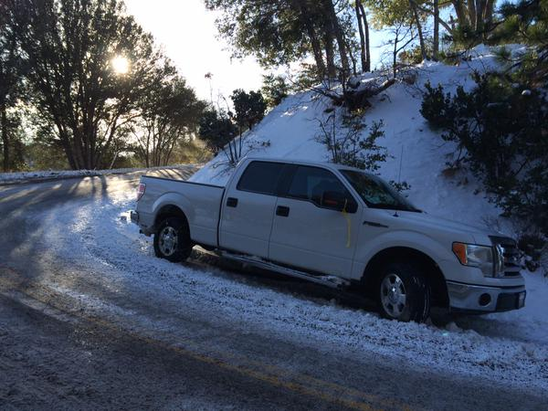 . A vehicle stranded overnight on Highway 138 in Crestline. A cold storm hit Southern California on Dec. 30 and brought snow to the mountain communties.