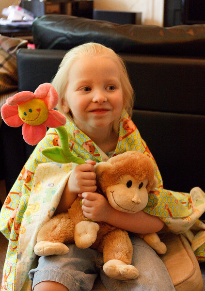 Chloe received these three cuddly things - and two more hand-made blankets -  in a package from Grandma Pam - May 2011