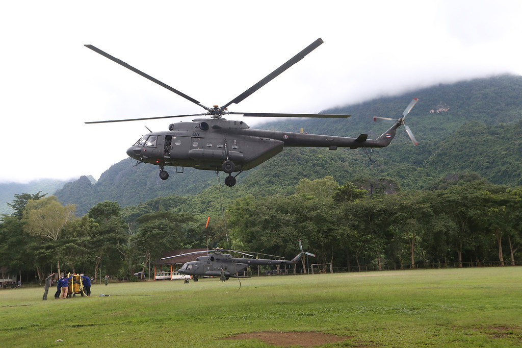 . A military transport helicopter prepares to carry drill machine to be used for the search of missing 12 boys and their soccer coach, in Mae Sai, Chiang Rai province, in northern Thailand, Monday, July 2, 2018. Rescue divers are advancing in the main passageway inside the flooded cave in northern Thailand where the boys and their coach have been missing more than a week. (AP Photo/Sakchai Lalit)
