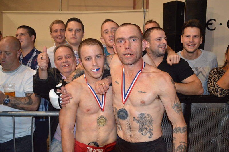 Dean Hart poses with his Dad and opponent Bob Bowles after his TKO victory in an amateur MMA contest at the Swindon Fightclub CAGED event on the 5th October 2013