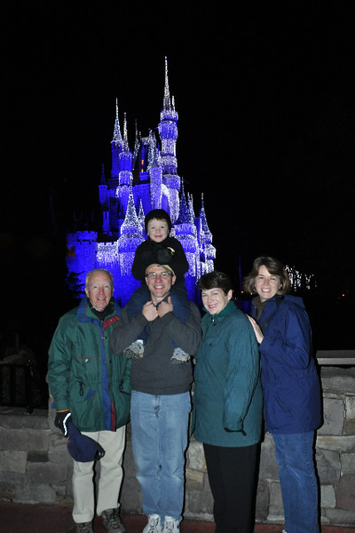 family in front of Cinderella's Castle at night.jpg
