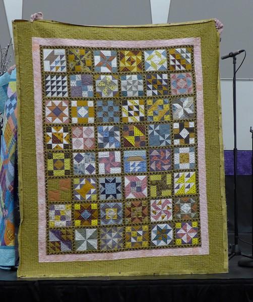 John Putnam made this 48 block sampler using the Accuquilt Go die cutter machine.  Civil War reproduction fabrics.