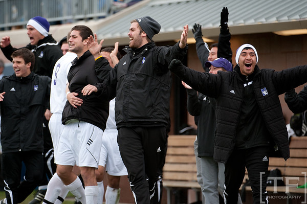 Nov 13, 2011; Ann Arbor, MI, USA; Northwestern Wildcats bench celebrate forward Oliver Kupe (8) winning goal against Penn State Nittany Lions goalkeeper Andrew Wolverton (1) in the second half at the final game of the 2011 Big Ten Championship at Michigan Soccer Stadium. Wildcats won 2-1. Mandatory Credit: Tim Fuller-US PRESSWIRE