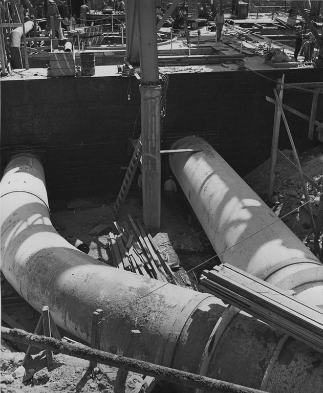 . When Owens River plant no. 2 was completed, water from the Owens River flowed through the 92-inch penstock on the hill above, down into this Y-branch. When channeled through the right fork, the water will turn the rotor on the generator to produce the electrical power. Photo date: June 20, 1951.   (Los Angeles Public Library)