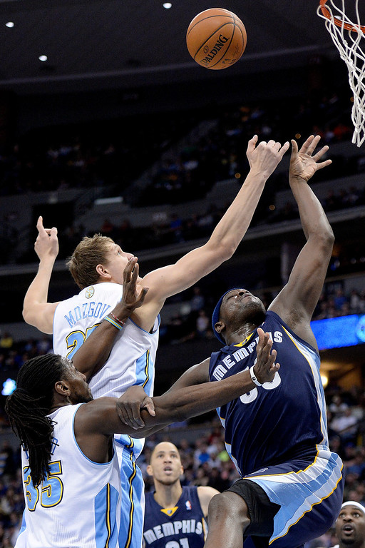. Denver Nuggets center Timofey Mozgov (25) knocks a rebound away from Memphis Grizzlies forward Zach Randolph (50) as he holds forward Kenneth Faried (35) off during the second quarter. (Photo by AAron Ontiveroz/The Denver Post)