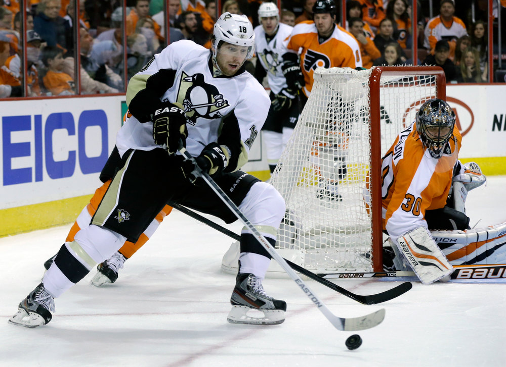 Description of . Philadelphia Flyers goalie Ilya Bryzgalov, of Russia (30) watches as Pittsburgh Penguins' James Neal (18) tries to control the puck during the first period of an NHL hockey game Saturday, Jan.19, 2013, in Philadelphia. (AP Photo/Mel Evans)