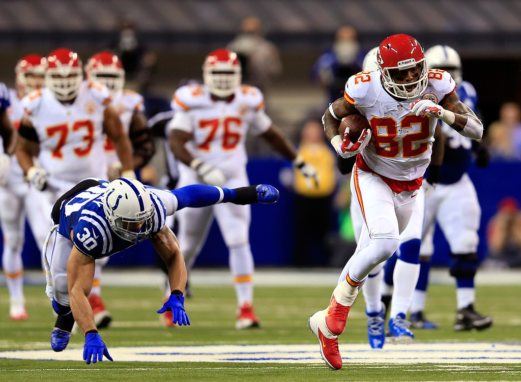 . INDIANAPOLIS, IN - JANUARY 04:  Wide receiver Dwayne Bowe #82 of the Kansas City Chiefs runs with the ball as strong safety LaRon Landry #30 of the Indianapolis Colts defends during a Wild Card Playoff game at Lucas Oil Stadium on January 4, 2014 in Indianapolis, Indiana.  (Photo by Rob Carr/Getty Images)