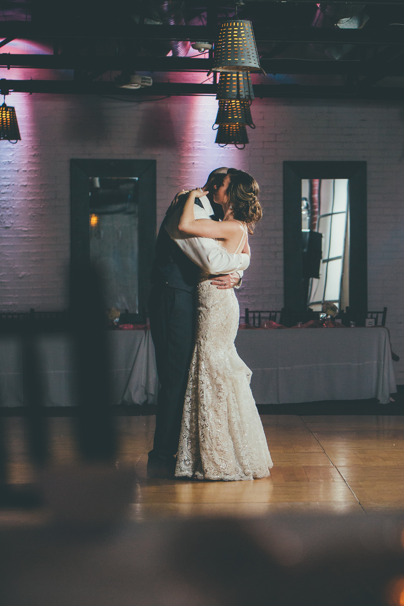 bride and groom slow dancing at their wedding