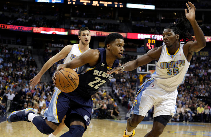 . Memphis Grizzlies\' Rudy Gay (22) drives against Denver Nuggets\' Kenneth Faried (35) in the first quarter of a NBA game in Denver on Friday, Dec. 14, 2012. Nuggets\' Danilo Gallinaria trails the play. (AP Photo/Joe Mahoney)