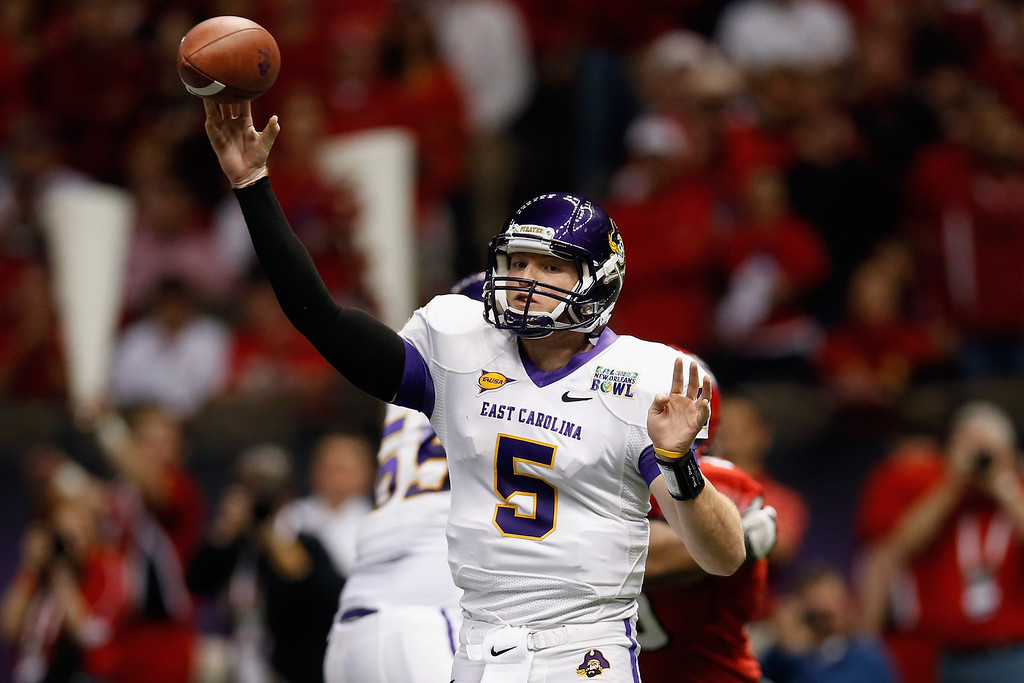 . Shane Carden #5 of the East Carolina Pirates throws a pass against the Louisiana-Lafayette Ragin Cajuns during the R+L Carriers New Orleans Bowl at the Mercedes-Benz Superdome on December 22, 2012 in New Orleans, Louisiana.  (Photo by Chris Graythen/Getty Images)