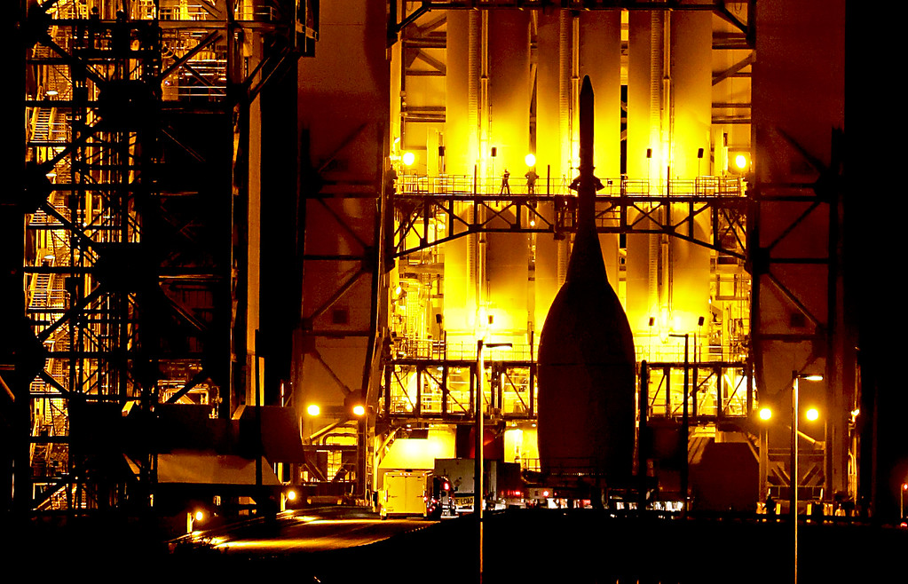 . After a 22 mile journey from the Launch Abort System Facility at the Kennedy Space Center, the Orion Spacecraft arrives at Space Launch Complex 37B at the Cape Canaveral Air Force Station, Wednesday, Nov. 12, 2014, in Cape Canaveral, Fla. The test flight for Orion is scheduled to launch on Dec. 4. (AP Photo/John Raoux)