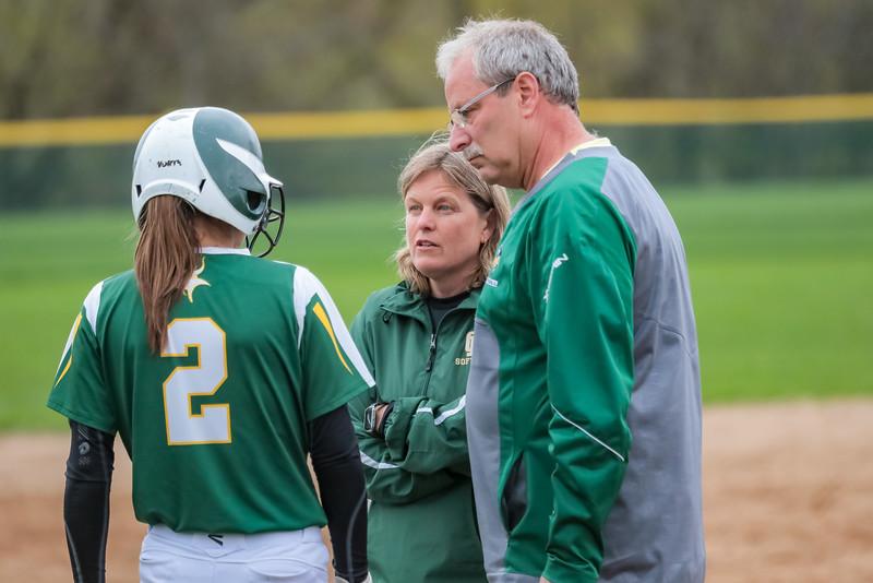 Oxford Hills' coaches Cindy Goddard and Dan Daniels talk with Kiara McLeod during a timeout