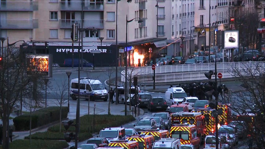 . A screengrab taken from an AFP TV video shows a general view of members of the French police special forces launching the assault at a kosher grocery store in Porte de Vincennes, eastern Paris, on January 9, 2015 where at least two people were shot dead on January 9 during a hostage-taking drama at a Jewish supermarket in eastern Paris, and five people were being held, official sources told AFP. Several hostages were freed after French commandos stormed a Jewish supermarket in eastern Paris where an assailant was holed up on January 9. After several explosions, police stormed the shop in Portes de Vincennes and everal hostages exited the store shortly afterwards and were taken to safety.   AFP PHOTO / AFPTV / GABRIELLE  CHATELAIN/AFP/Getty Images