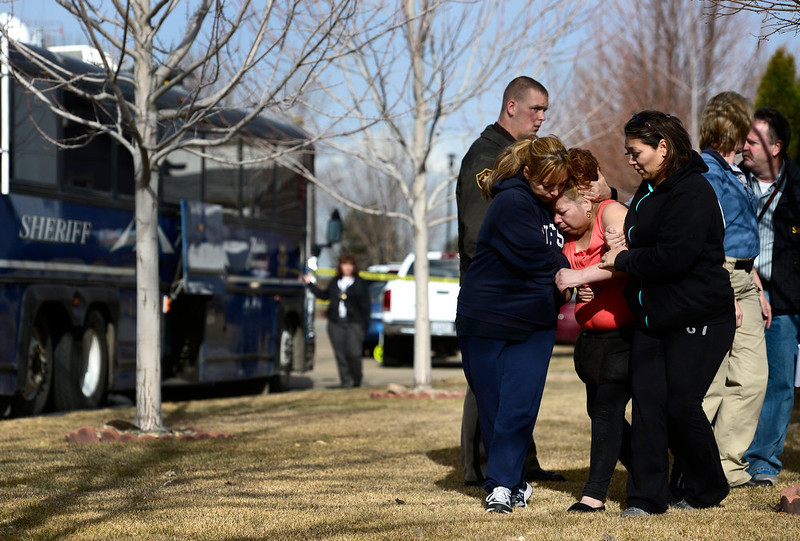 . An unidentified woman is helped from the scene as she cries, Tuesday, Dec. 18, 2012, in Longmont. (Matthew Jonas/Times-Call)