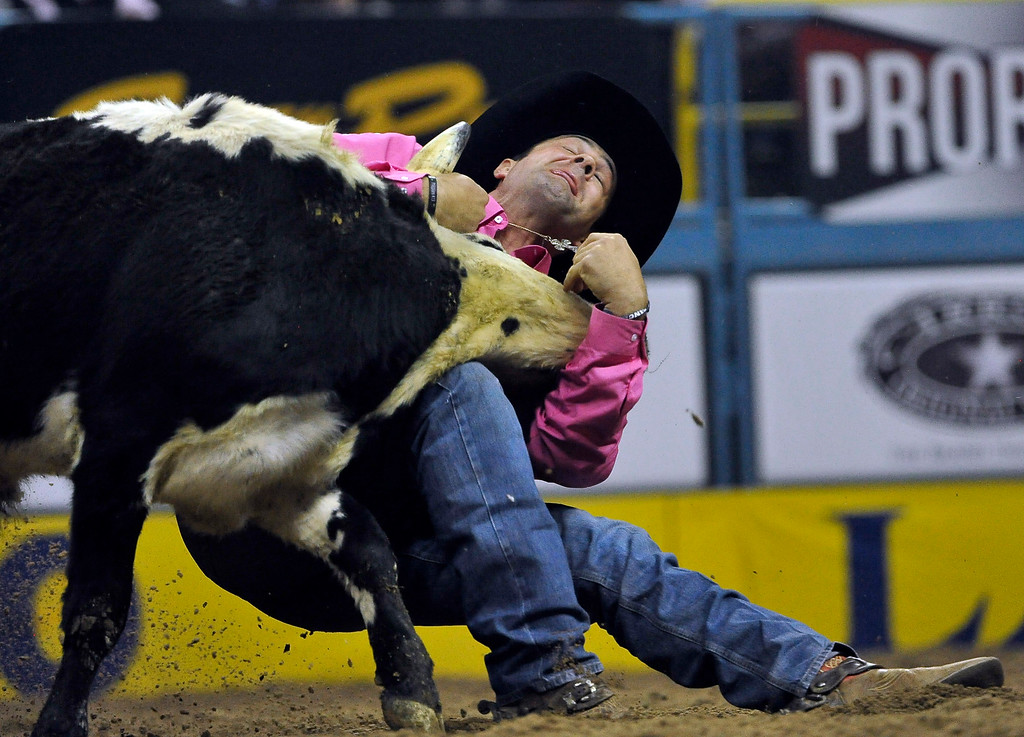 . Bray Armes of Ponder, Texas competes in the steer wrestling during the fifth go-round of the National Finals Rodeo at the Thomas & Mack Center on Monday, Dec. 8, 2014, in Las Vegas.  (AP Photo/Las Vegas Review Journal, David Becker)