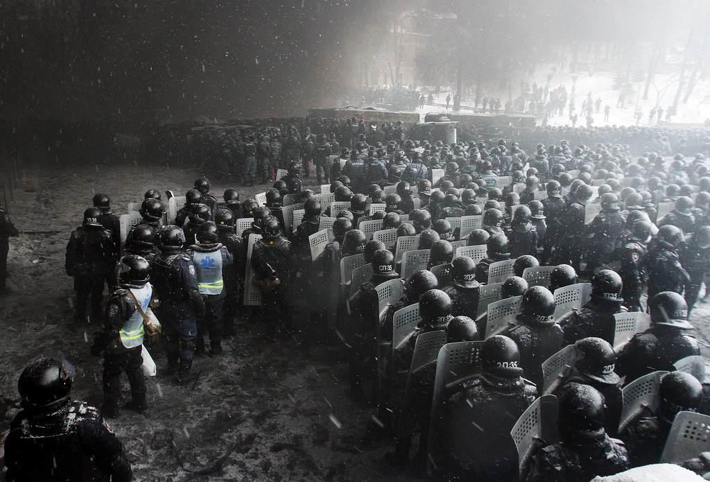 . Riot police officers gather as they clash with protestors in the center of Kiev on January 22, 2014.  AFP PHOTO/ ANATOLII BOIKO/AFP/Getty Images