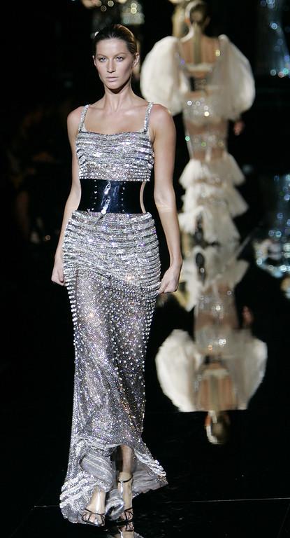 . Brazilian supermodel Gisele Bundchen wears a creation of Dolce & Gabbana women\'s Autumn-Winter 2007/2008 collection, part of the Milan Fashion Week, unveiled in Milan, Italy, Thursday, Feb. 22, 2007. (AP Photo/Antonio Calanni)