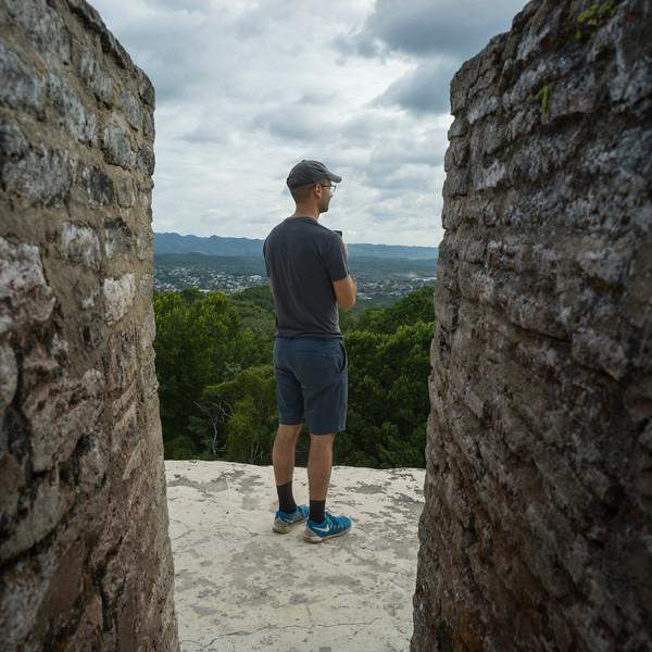 Tourist at Ancient Mayan Archaeological Site, San Jose Succotz, Cayo District, Belize