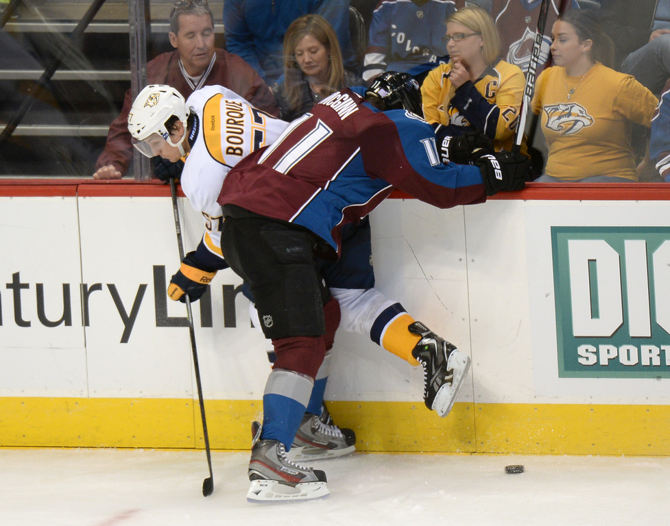 . DENVER, CO - OCTOBER 04 : Jamie McGinn of the Colorado Avalanche (11) checks Gabriel Bourque of  the Nashville Predators (57) in the 3rd period of the game at the Pepsi Center. Denver, Colorado. October 4, 2013. Colorado won 3-1. (Photo by Hyoung Chang/The Denver Post)