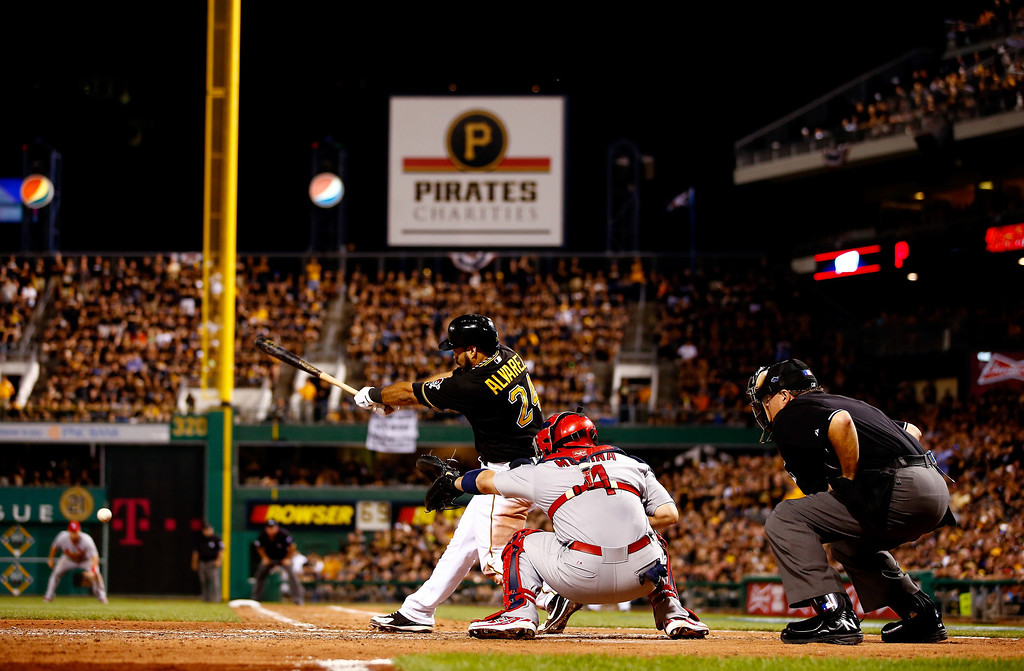 . Pedro Alvarez #24 of the Pittsburgh Pirates hits an RBI single in the eighth inning against the St. Louis Cardinals during Game Three of the National League Division Series at PNC Park on October 6, 2013 in Pittsburgh, Pennsylvania.  (Photo by Jared Wickerham/Getty Images)