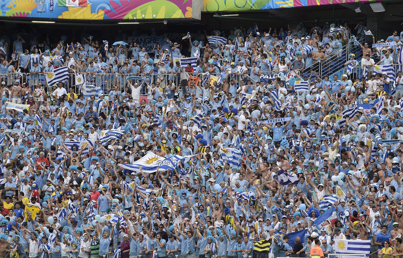. Uruguayan fans cheer prior to a Group D football match between Italy and Uruguay at the Dunas Arena in Natal during the 2014 FIFA World Cup on June 24, 2014.   DANIEL GARCIA/AFP/Getty Images