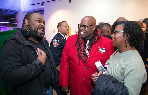 02/28/20 Wesley Bunnell | StaffrrTwenty five men were honored at Gallery 66 on Friday night for their involvement in the community as part of Black History Month. Honoree Duane P. Pierce of Paradym Academy is shown middle.