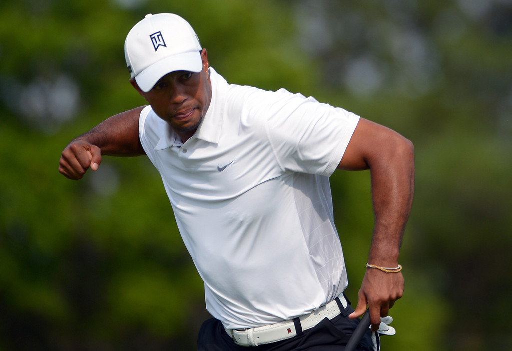 . Tiger Woods pumps his fist after making a putt for eagle on the 16th green during the third round of the Arnold Palmer Invitational golf tournament in Orlando, Fla., Saturday, March 23, 2013. (AP Photo/Phelan M. Ebenhack)