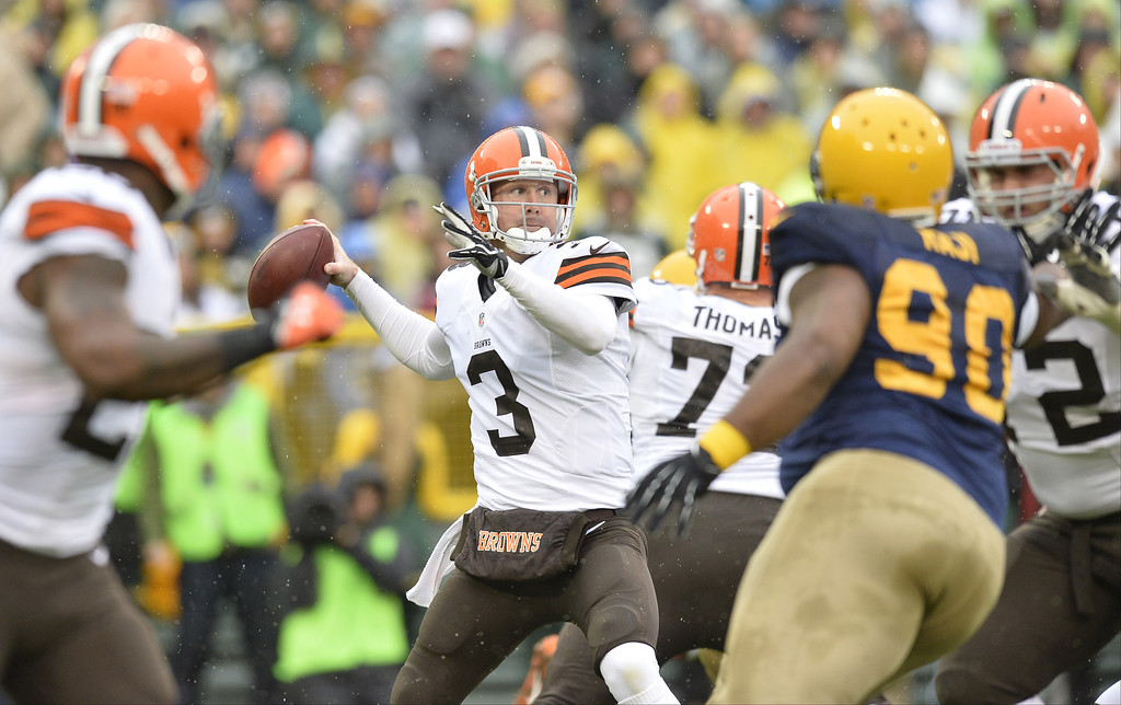 . Quarterback Brandon Weeden #3 of the Cleveland Browns drops back to pass during the first quarter against the Green Bay Packers at Lambeau Field on October 20, 2013 in Green Bay, Wisconsin.  (Photo by Brian Kersey/Getty Images)