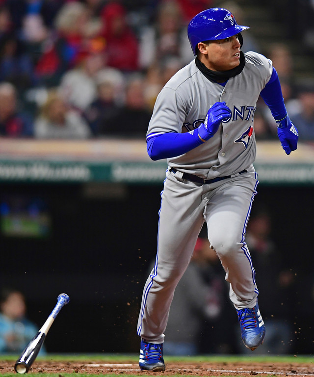 . Toronto Blue Jays\' Aledmys Diaz watches the ball after hitting a three-run home run off Cleveland Indians starting pitcher Mike Clevinger during the fourth inning of a baseball game Friday, April 13, 2018, in Cleveland. (AP Photo/David Dermer)