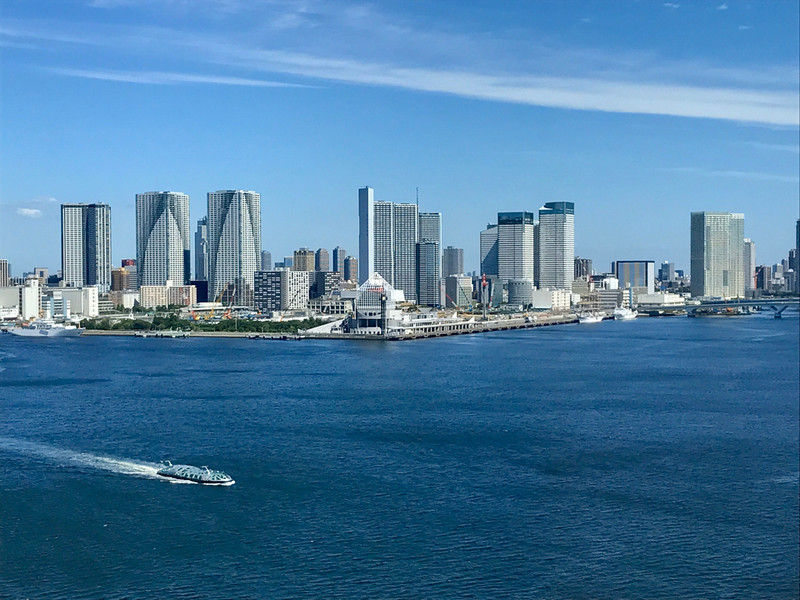 Viewing the Tokyo skyline fronted by the blue water of the harbor on a first-time visit to Japan.