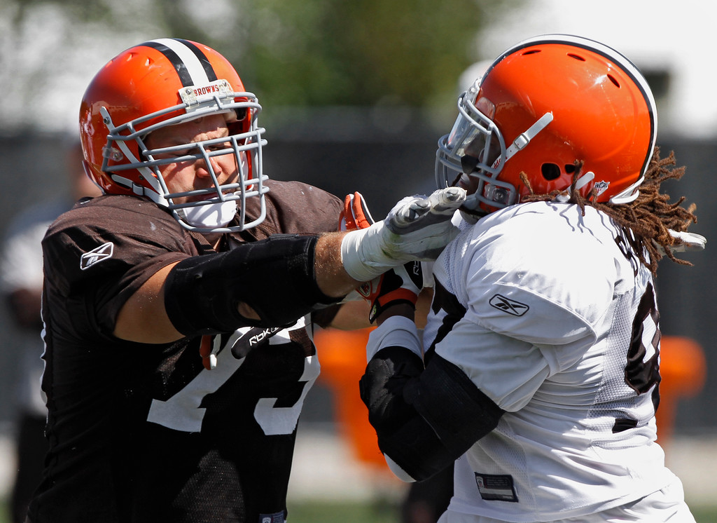 . Cleveland Browns offensive tackle Joe Thomas, left, blocks defensive lineman Jabaal Sheard during practice at the NFL football team\'s training camp in Berea, Ohio, Monday, Aug. 29, 2011. (AP Photo/Mark Duncan)