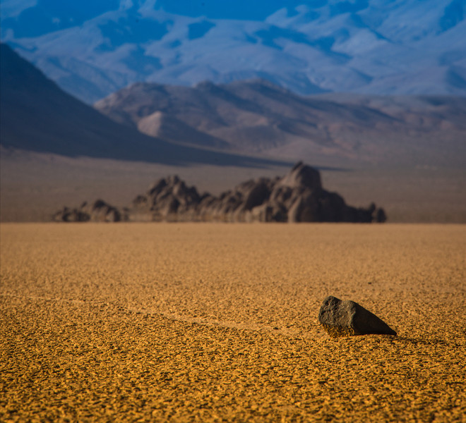 "The Polar Opposite Here is another photo from this mysterious part of Death Valley, where the rocks appear to move on their own accord. If you'd like to see the other photo I took of this place at midnight under the moon, just click on the ""Death Valley"" category under this post.In the distance there, you can see that tremendous, heavy black rock. It remains in the middle of the lakebed in that pronounced manner, like a giant iron ship that is using ancient magnets to direct rocks around the lakebed.- Trey RatcliffClick here to read the rest of this post at the Stuck in Customs blog."