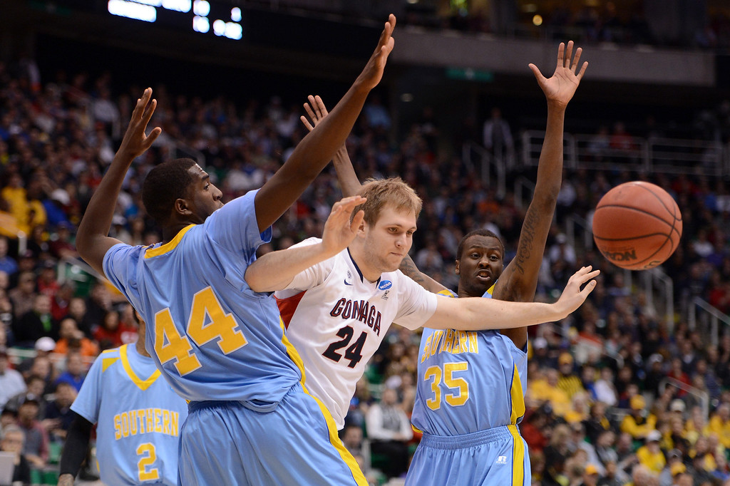 . SALT LAKE CITY, UT - MARCH 21:  Przemek Karnowski #24 of the Gonzaga Bulldogs looses the ball between Javan Mitchell #44 and Madut Bol #35 of the Southern University Jaguars in the first half during the second round of the 2013 NCAA Men\'s Basketball Tournament at EnergySolutions Arena on March 21, 2013 in Salt Lake City, Utah.  (Photo by Harry How/Getty Images)