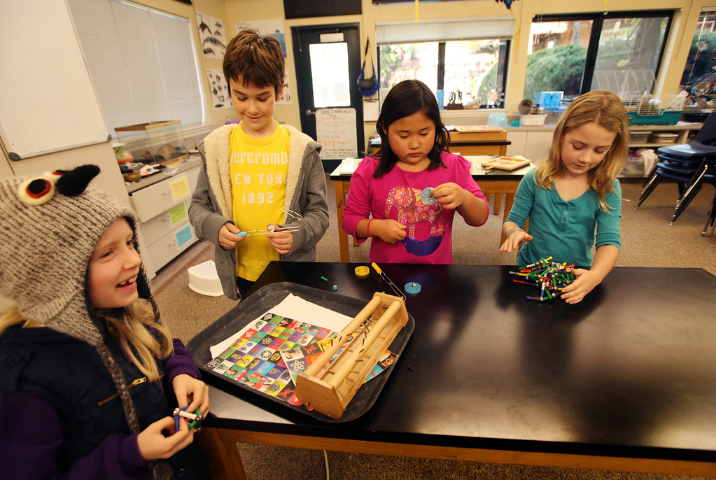 . Left to right, Saylor, Michael, Kira, and Annatie, all third graders, take advantage of the open science lab during recess to play with different objects at Head Royce School in Oakland, Calif. on Monday, Dec. 3, 2012.  Head Royce is in it\'s 125th year of operation. (Laura A. Oda/Staff)