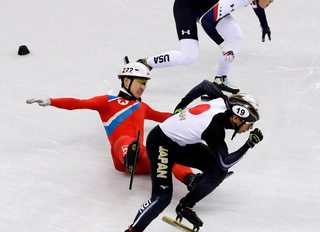 . Jong Kwang Bom, of North Korea, crashes during their men\'s 500 meters short track speedskating heat in the Gangneung Ice Arena at the 2018 Winter Olympics in Gangneung, South Korea, Tuesday, Feb. 20, 2018. (AP Photo/Morry Gash)