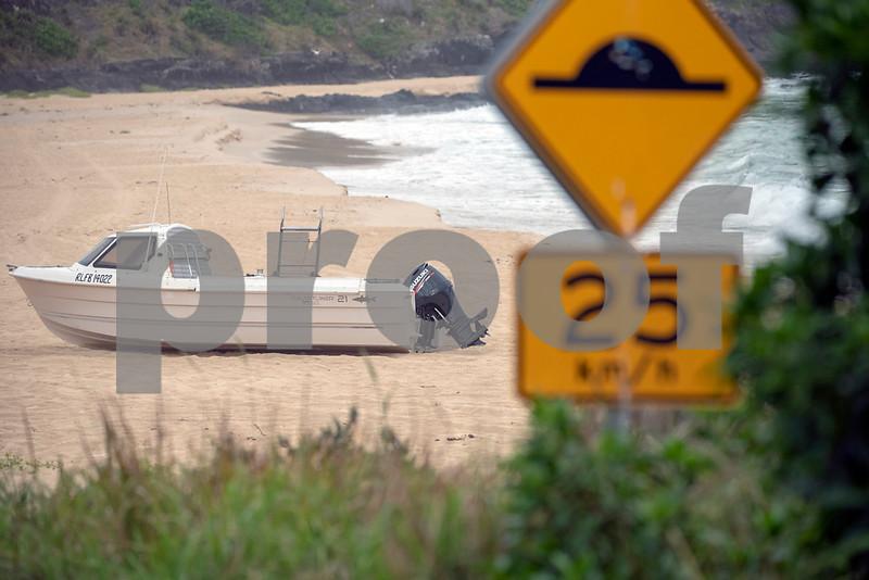 Seal rocks boat on beach 2.JPG