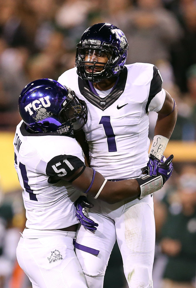 Description of . Safety Chris Hackett #1 of the TCU Horned Frogs celebrates a defensive stop against the TCU Horned Frogs during the Buffalo Wild Wings Bowl at Sun Devil Stadium on December 29, 2012 in Tempe, Arizona.  (Photo by Christian Petersen/Getty Images)