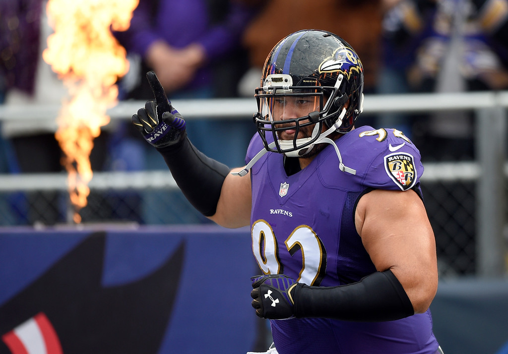 . Baltimore Ravens defensive end Haloti Ngata runs onto the field as he is introduced before an NFL football game against the San Diego Chargers, Sunday, Nov. 30, 2014, in Baltimore. (AP Photo/Nick Wass)