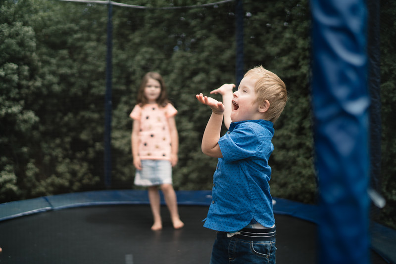 Delighted Boy on a Backyard Trampoline