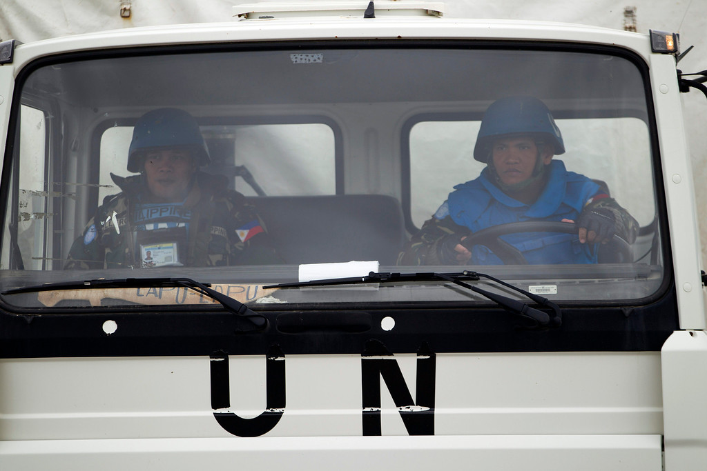 . A U.N. peacekeeper from the Philippines drives a UNDOF vehicle as it leaves the  Ziouani camp to cross into Syria at the Quneitra Crossing between Syria and the Israeli-controlled Golan Heights, Friday, March 8, 2013. The Philippine government said Syrian rebels failed to release 21 Filipino U.N. peacekeepers Friday and stuck to their demands for repositioning of Syrian government forces before any handover. The 21 peacekeepers were seized Wednesday near the Syrian village of Jamlah, just a kilometer (less than a mile) from the Israeli-controlled Golan Heights, where the U.N. force has patrolled a cease-fire line between Israel and Syria for nearly four decades. (AP Photo/Ariel Schalit)