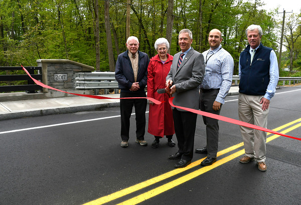 5/17/2018 Mike Orazzi | Staff Bristol Mayor Dave Merchant cuts the ribbon to officially open the bridge on North Main Street in Plymouth Thursday. Left to right: Richard and Barbara Traub, Mayor Merchant, Charlie Weigert and Steve McDonnell.